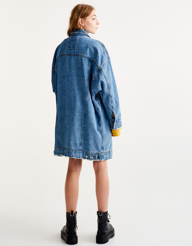 Oversized ripped denim jacket