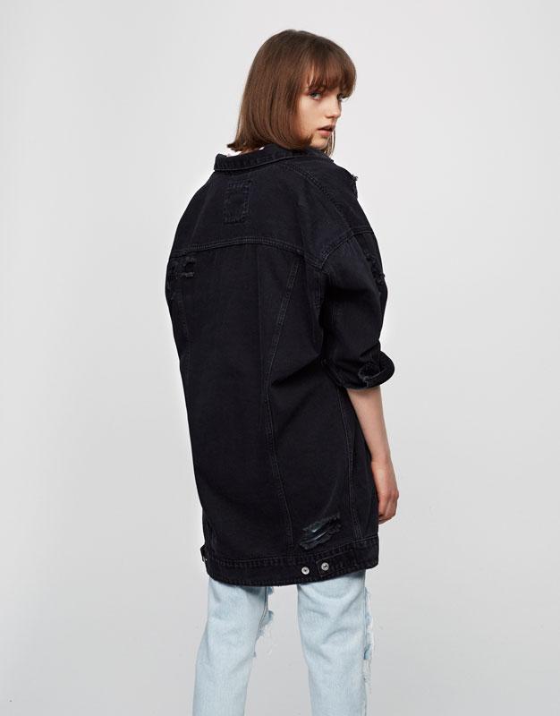 Oversized ripped denim jacket