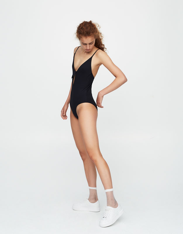 Swimsuit with tied neckline