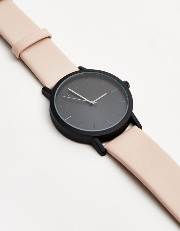 Watch with black dial and nude strap