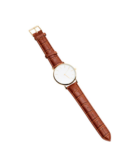 Watch with gold dial and brown strap