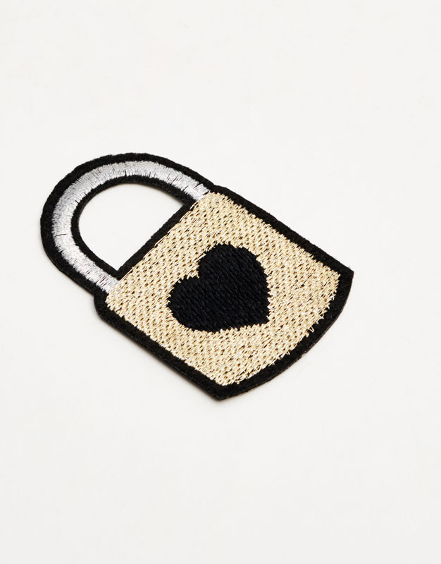 Lock-shaped patch with a heart