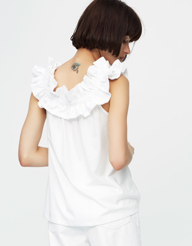 Top with ruffled neckline