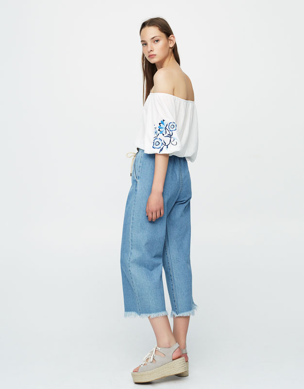 Crop top with floral embroidered sleeves