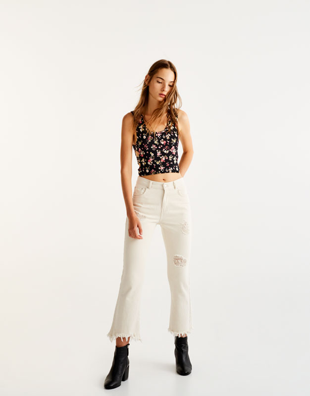 Sleeveless top with knotted sides