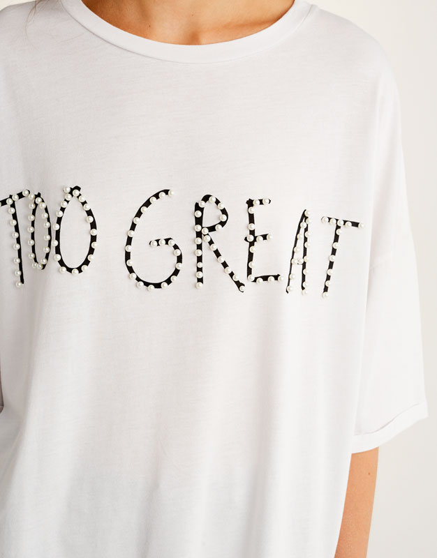 Oversized T-shirt with slogan set in faux pearls