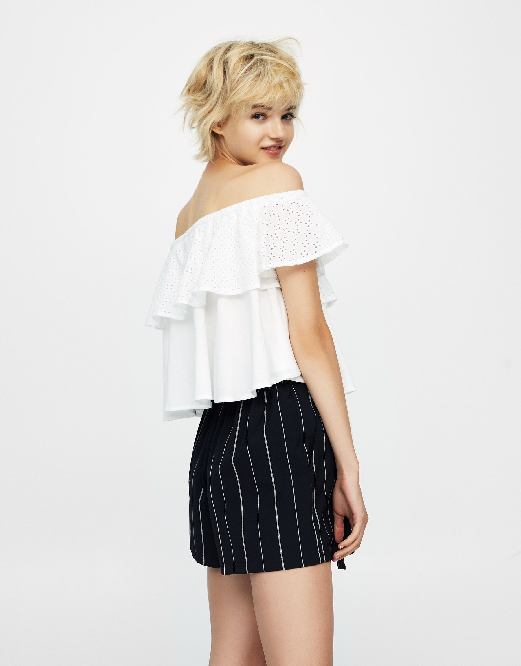Embroidered top with ruffled neckline