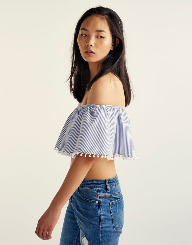 Top with bardot neckline and pompoms