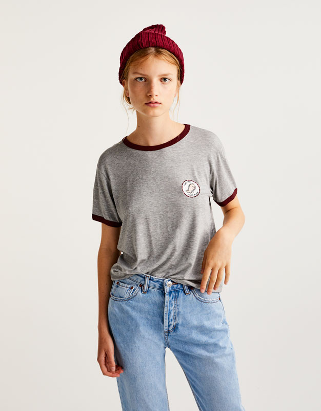 T-shirt with dinosaur patch