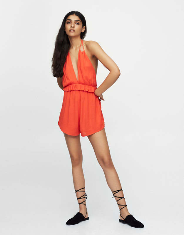 Jumpsuit with tied straps and plunging neckline in the back