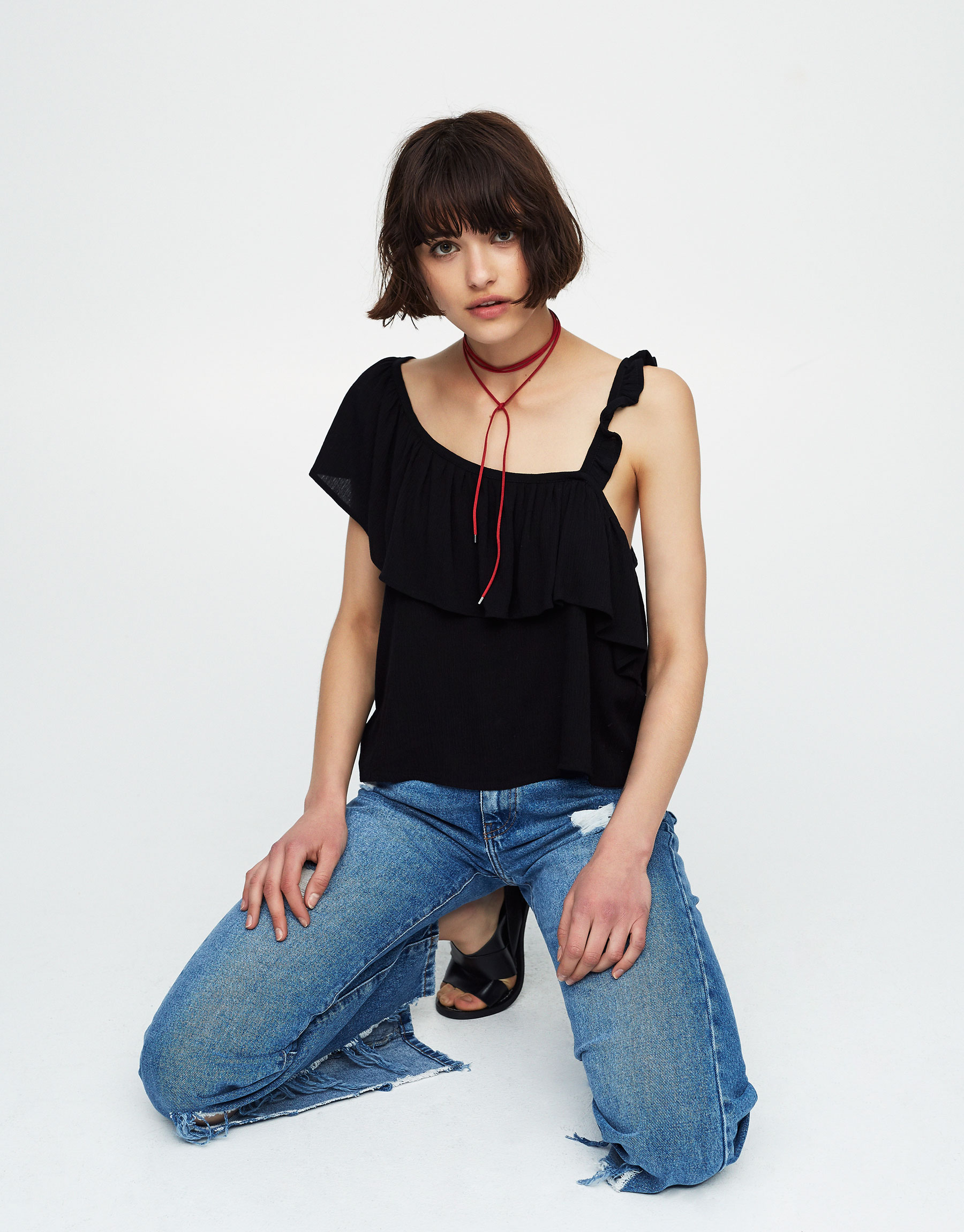 Asymmetric ruffled crop top