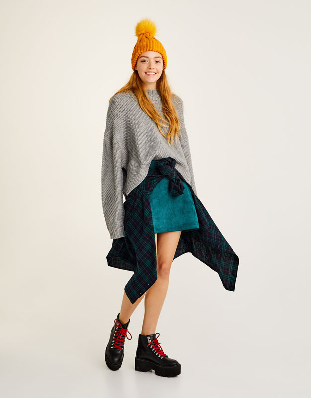 Knit sweater with closed neckline