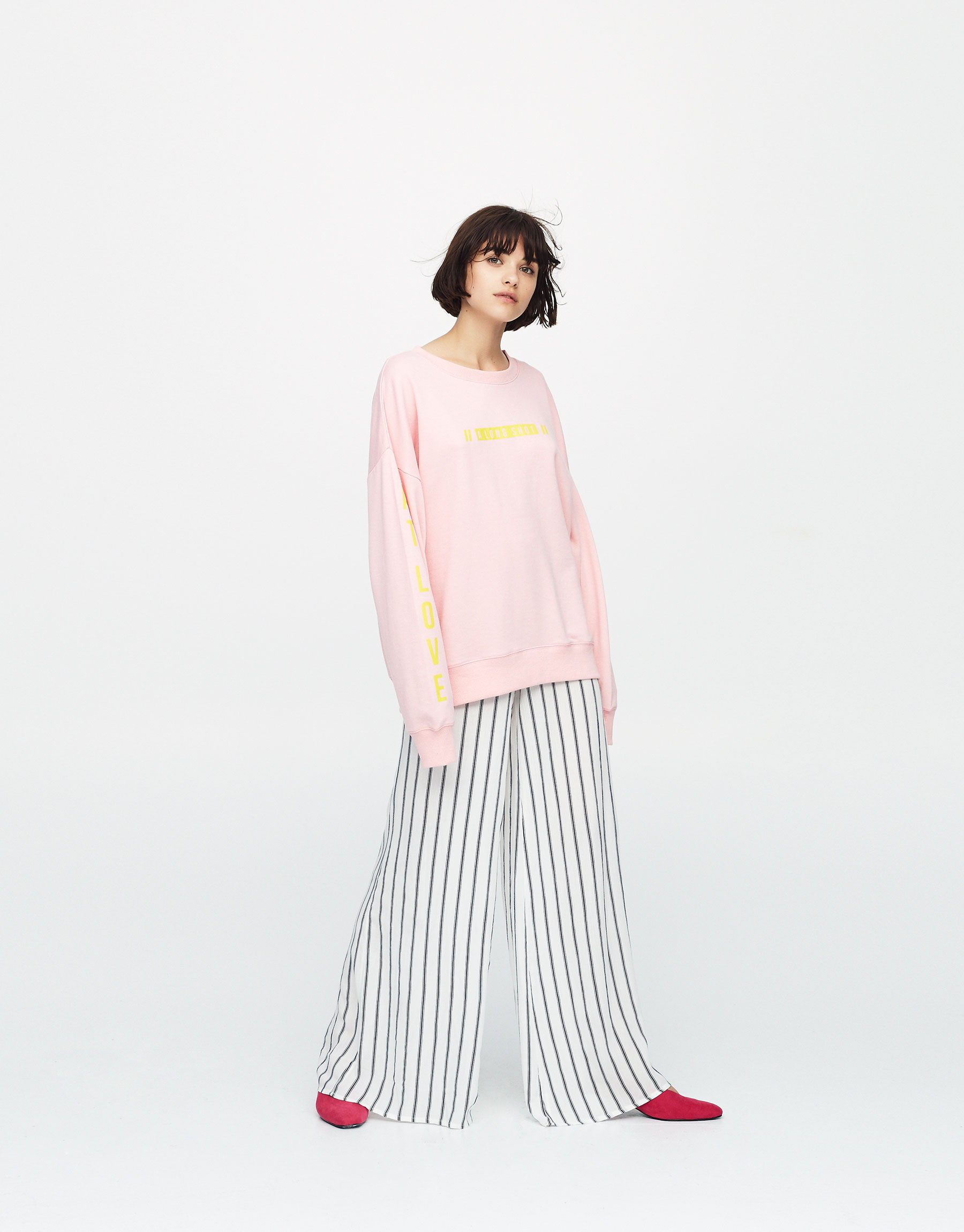 Sweatshirt with slogan on front and sleeve