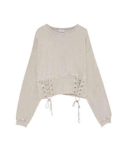 Sweatshirt with lace-up corset-style sides