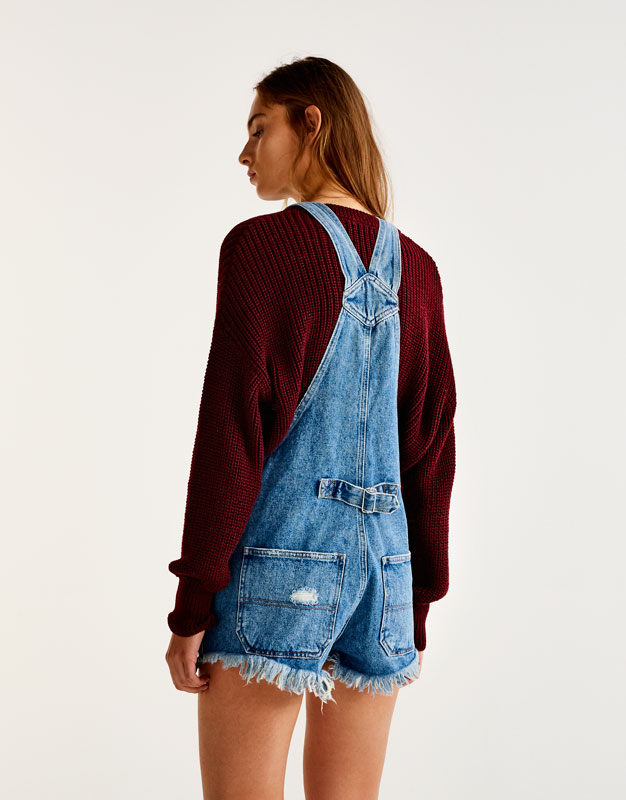 Ripped denim dungarees with cord