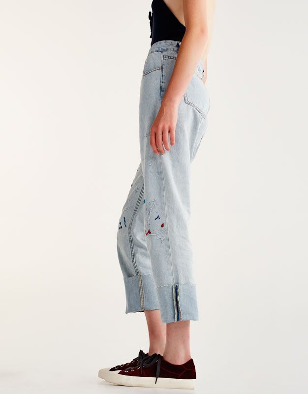 Straight embroidered jeans with paint splatter