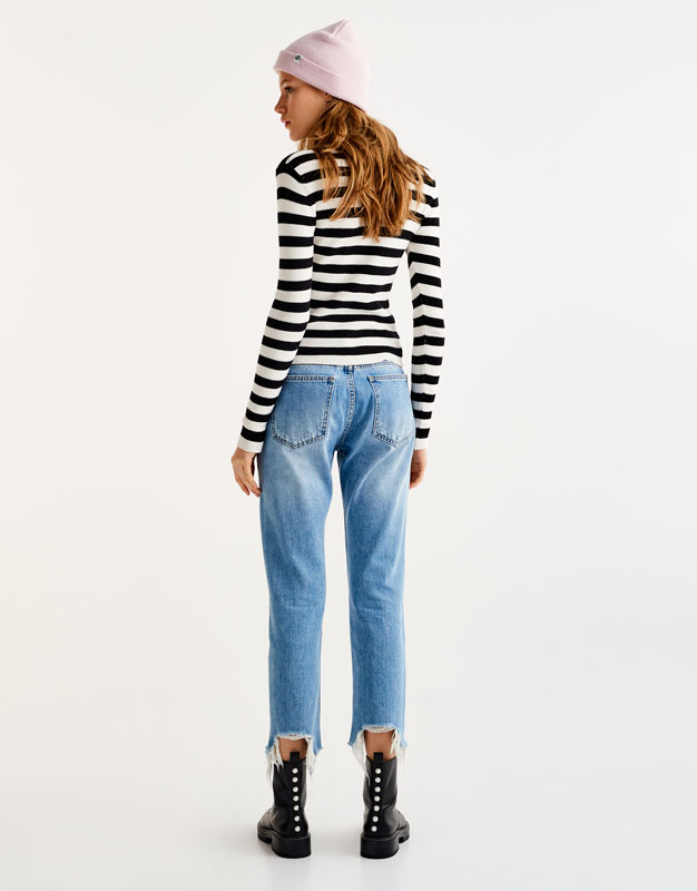 Straight low rise jeans with ripped hems