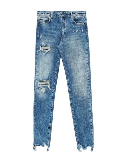 Skinny fit jeans with ripped hem