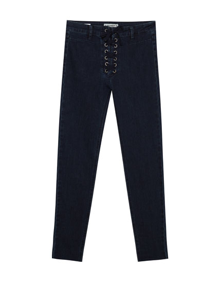 Mid-rise skinny corset-style jeans