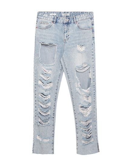 Boyfriend fit jeans with rips and frayed hem