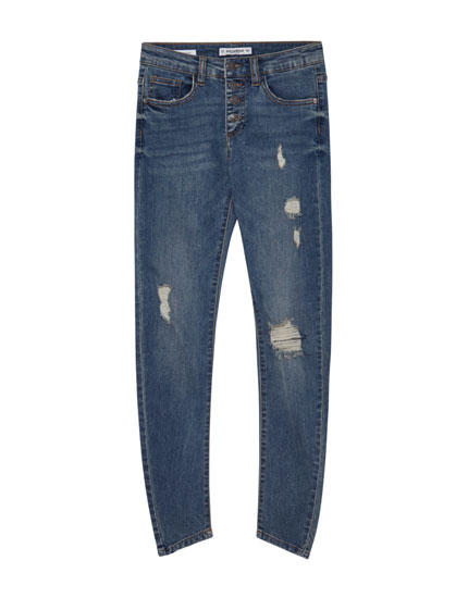Mid-rise skinny jeans with button fly