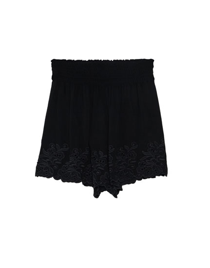 Shorts with embroidered hems
