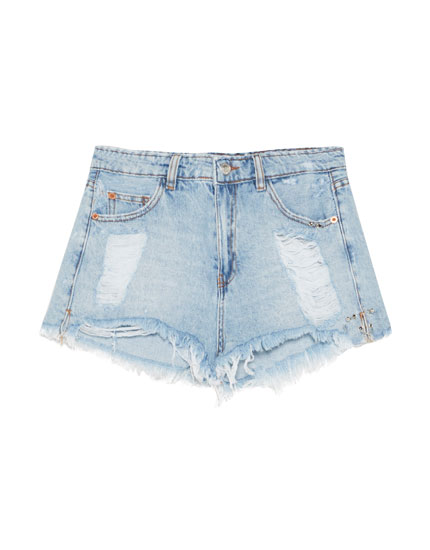 Ripped denim shorts with piercings