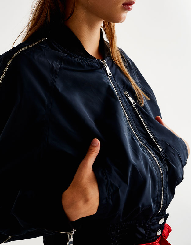 Bomber jacket with zips on sleeves