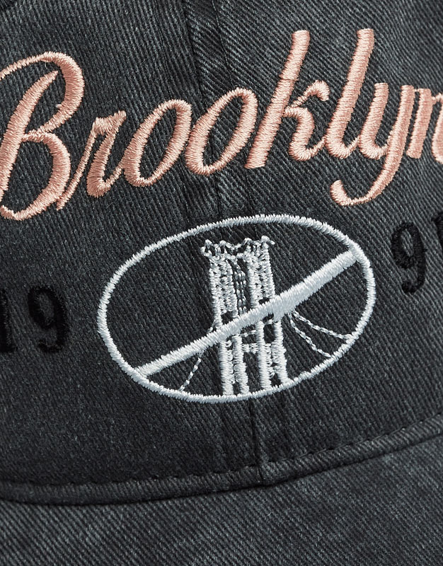 Cap with city names