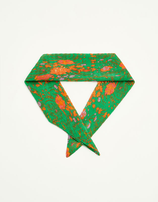 Green and orange speckled bandanna