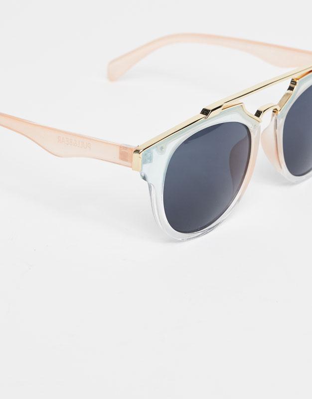Transparent sunglasses with metallic bridge