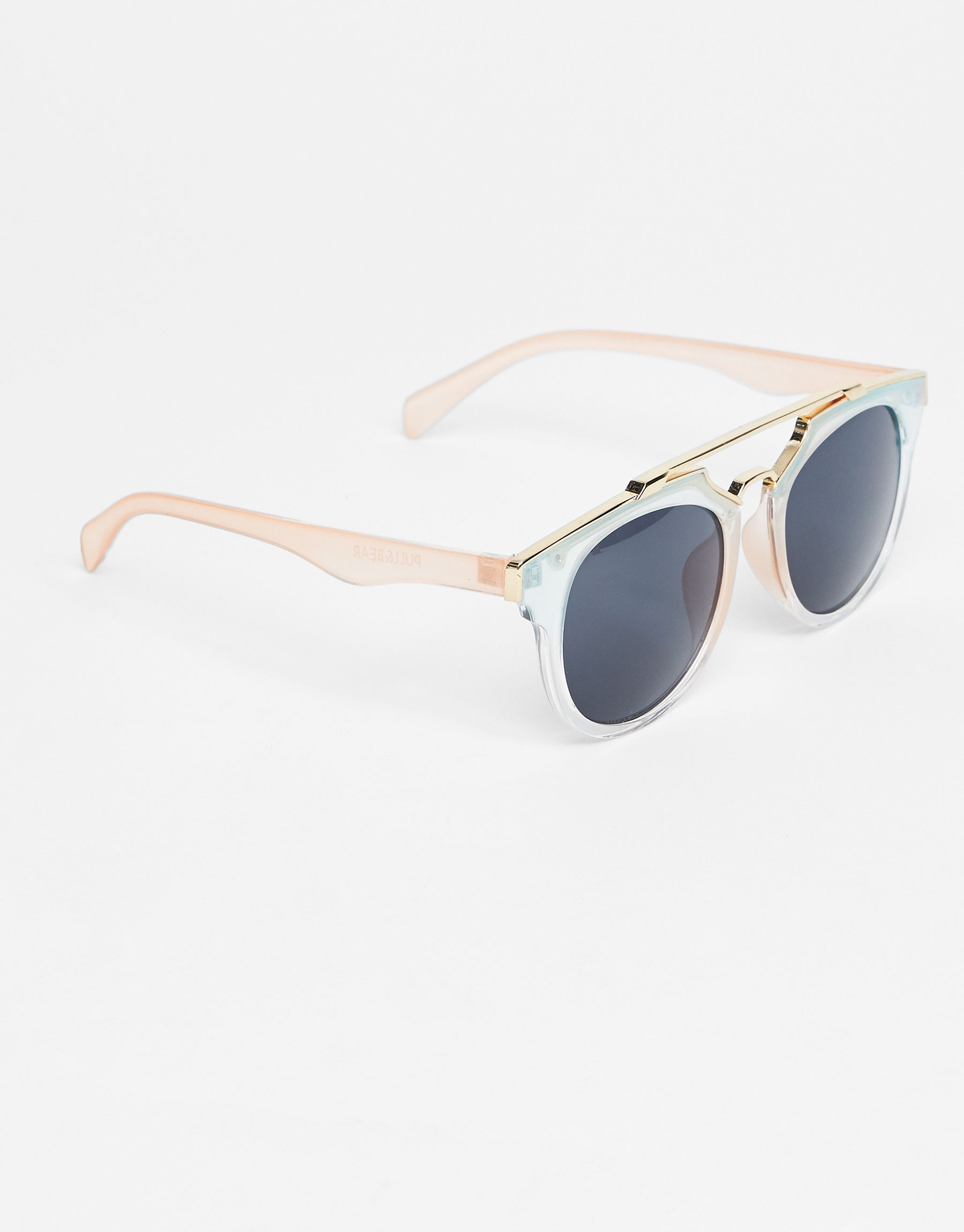 Transparent sunglasses with metallic bridge