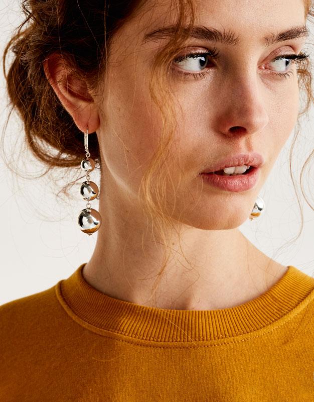 Earrings with ball pendants