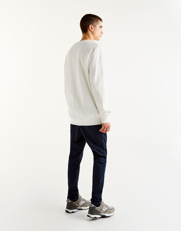 Sweatshirt with smartphone print on the pocket