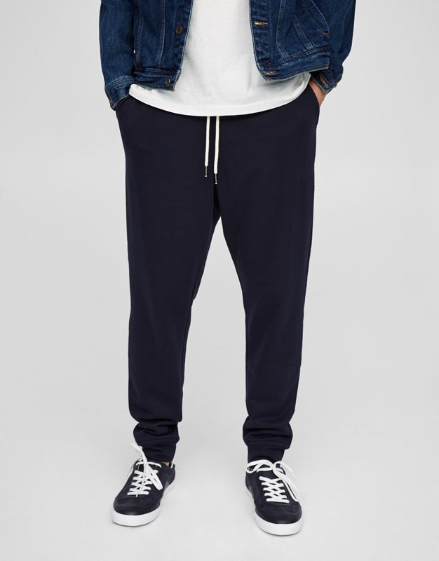 Jogging trousers with cuffed hem and cord