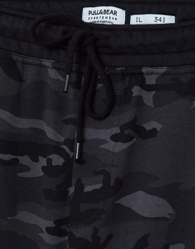 Grey camouflage print jogging trousers
