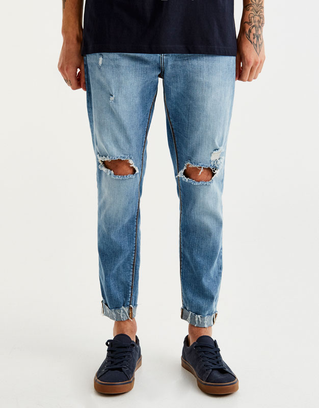 Bleached skinny jeans with ripped knees