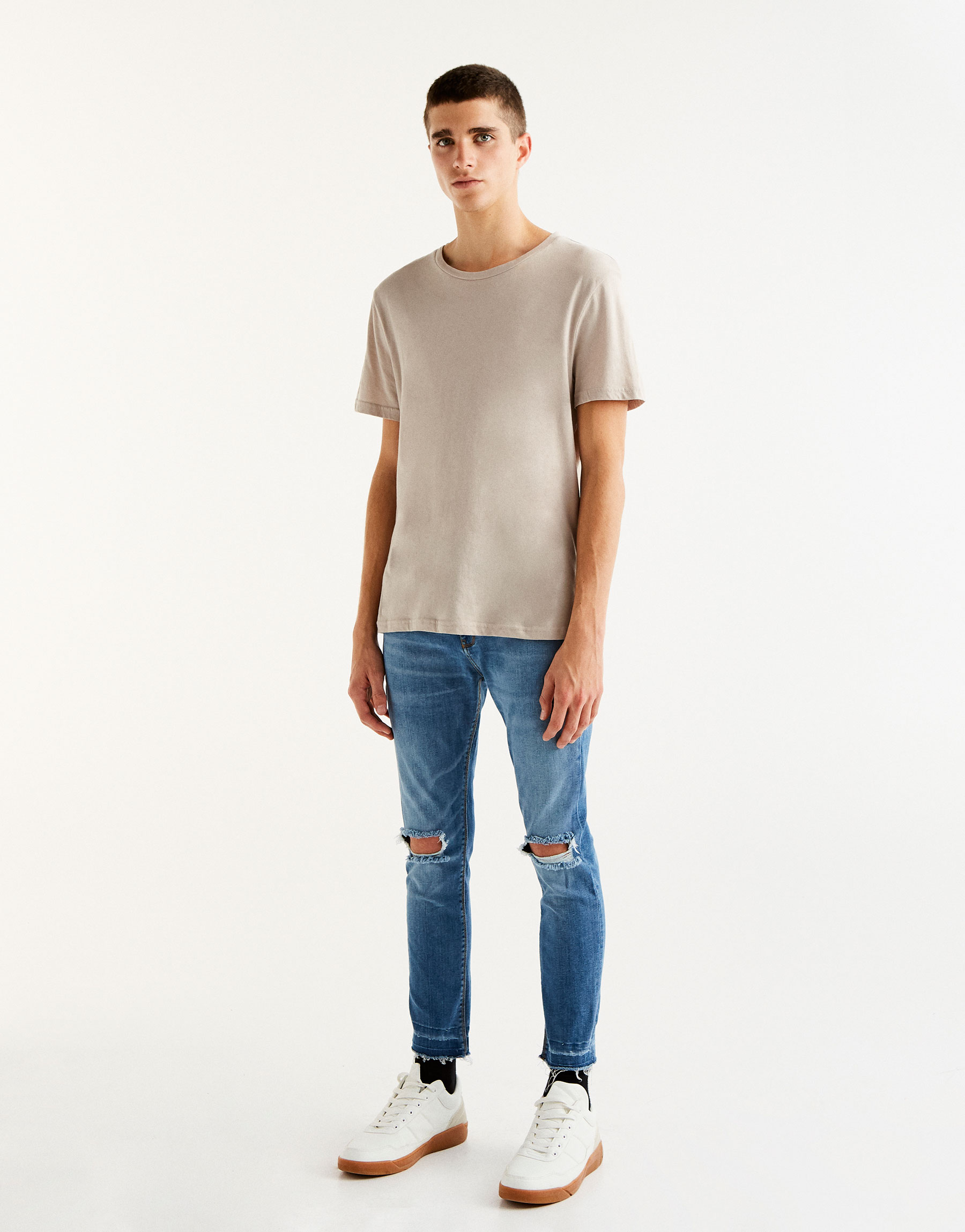 Jeans superskinny fit strappi ginocchio