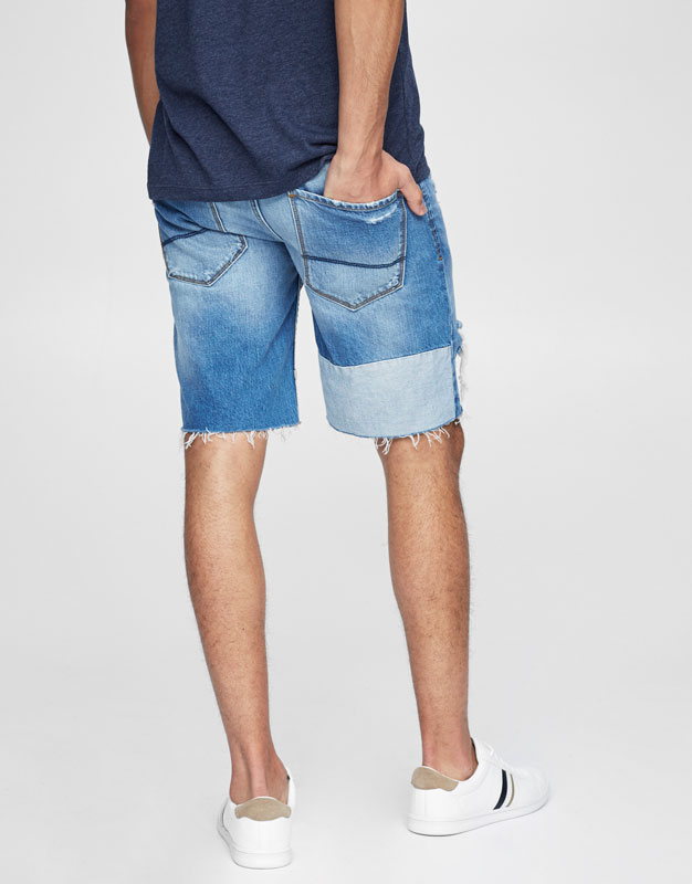 Contrasting ripped denim bermuda shorts.