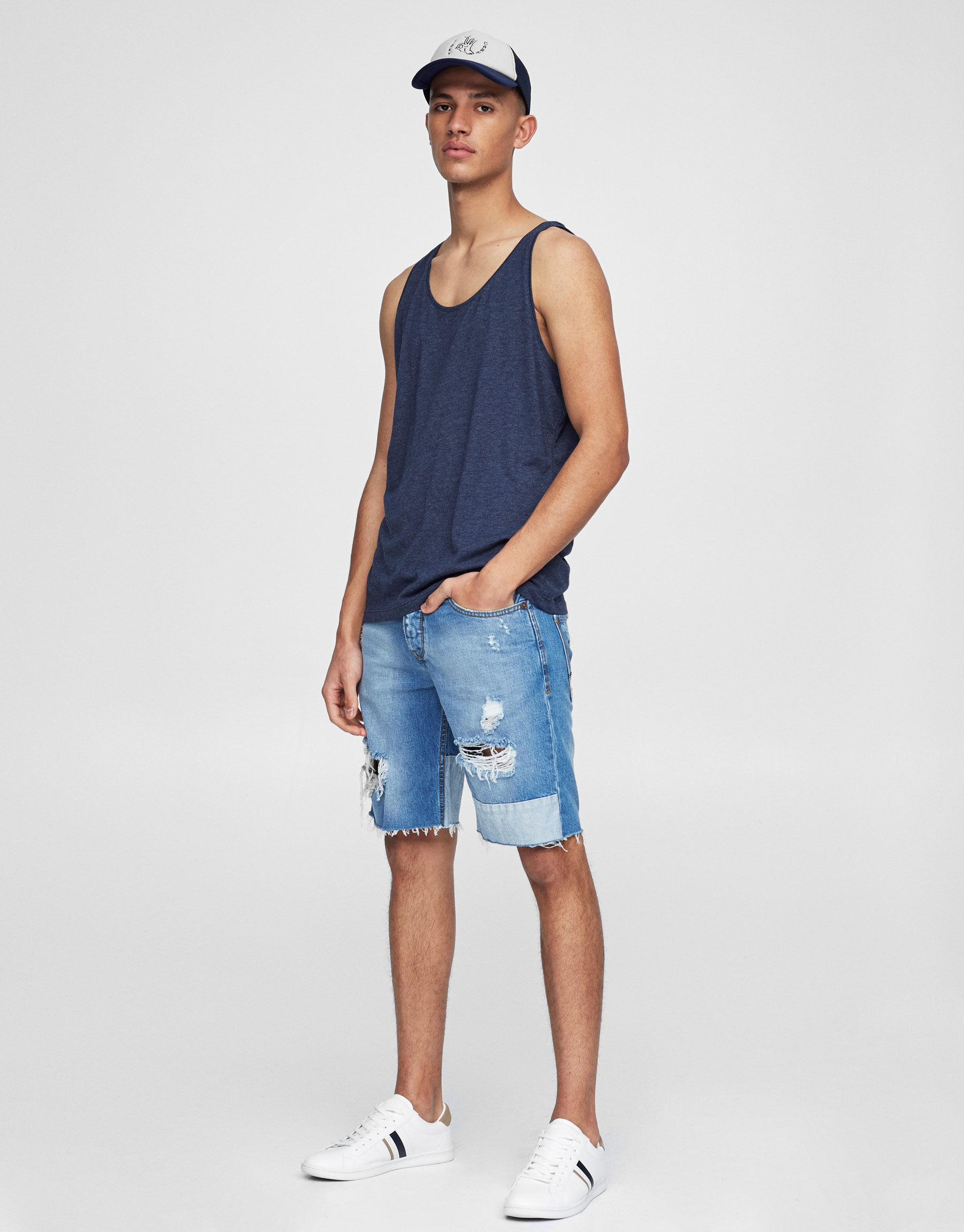 Contrasting ripped denim Bermuda shorts