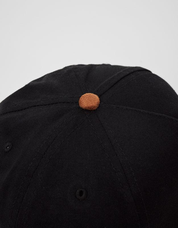 Black cap with brown visor