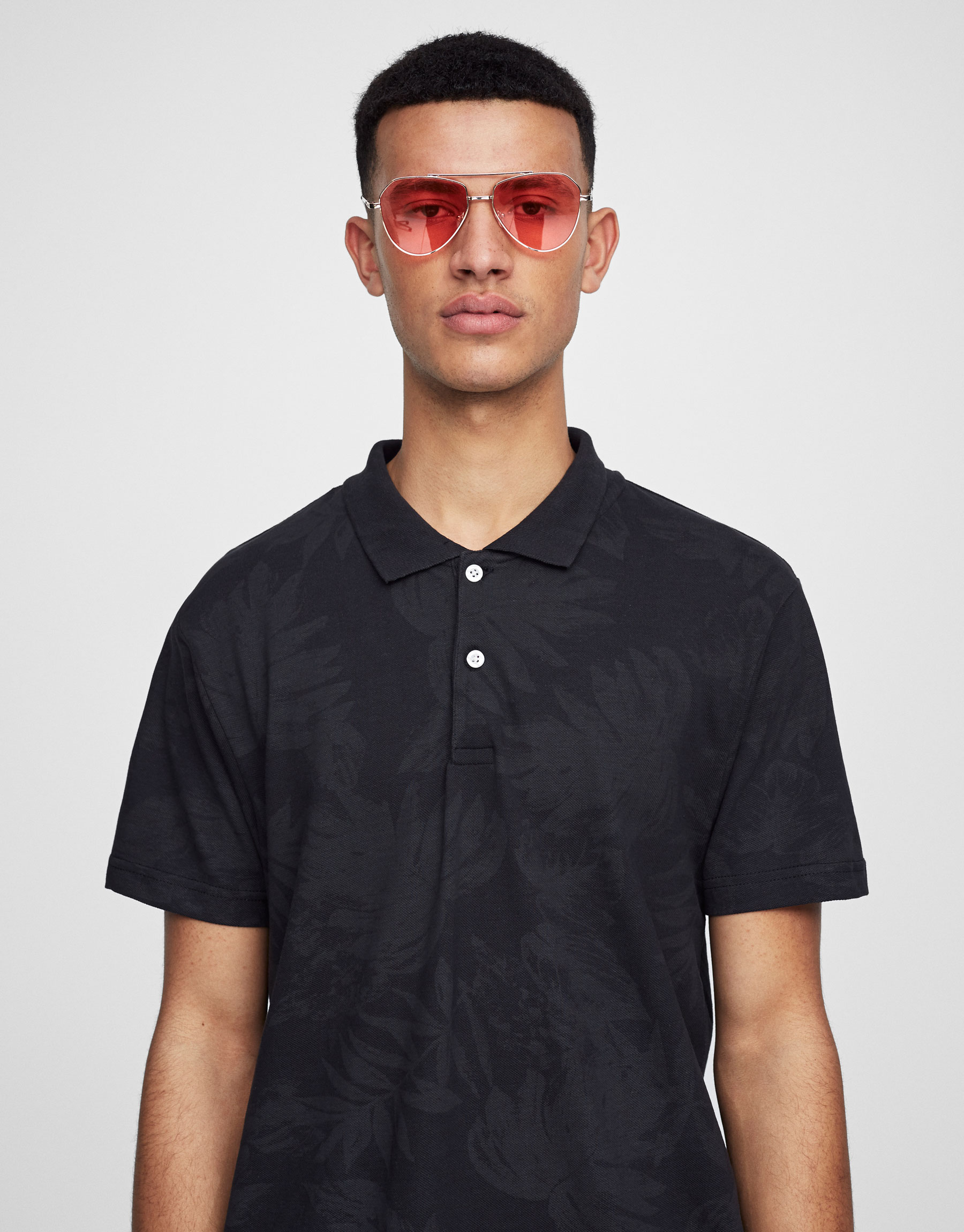 All-over leaf print polo shirt