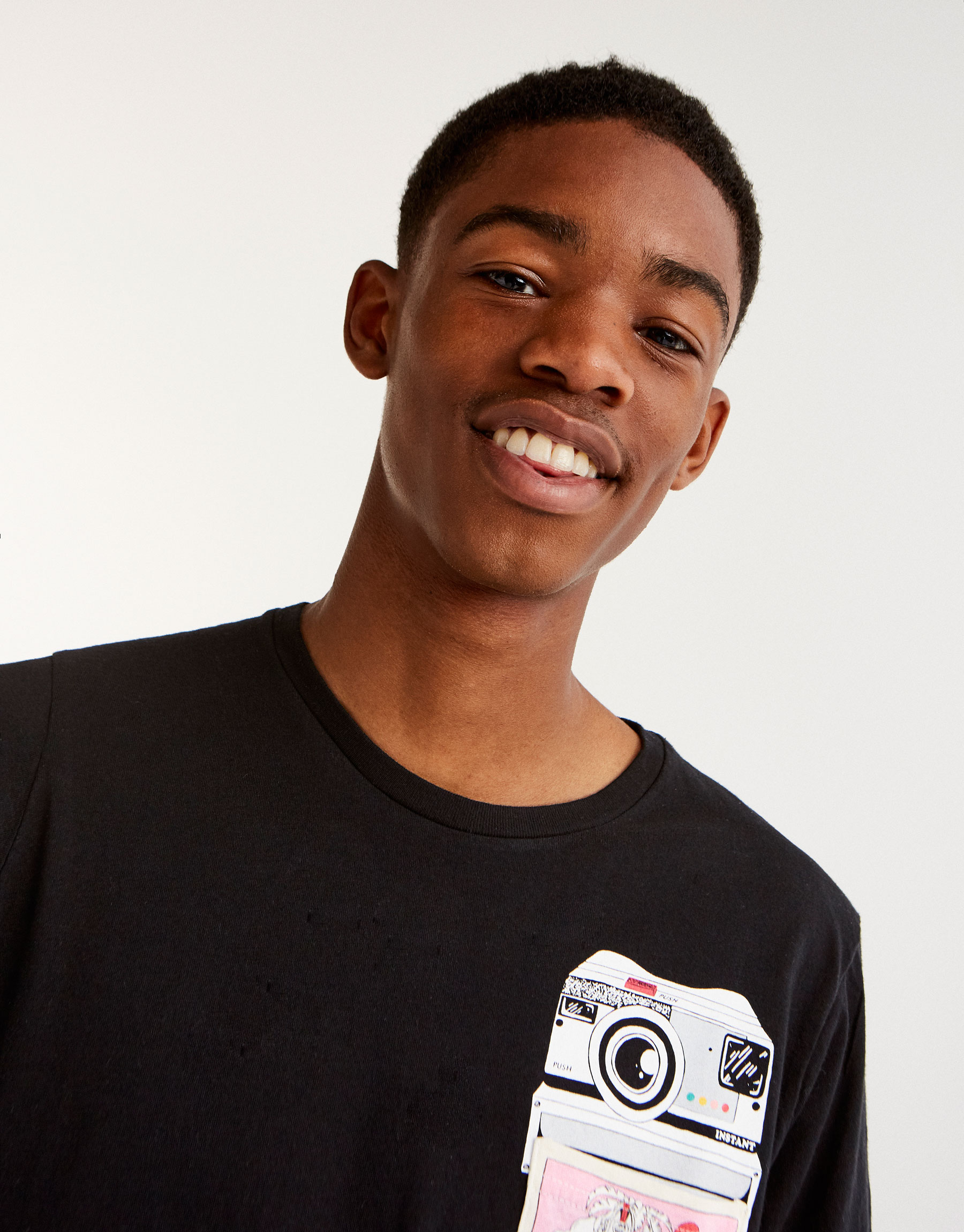 T-shirt with printed camera graphic on pocket