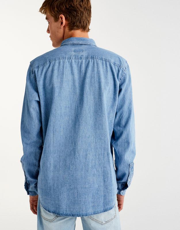 Camisa denim butxaca