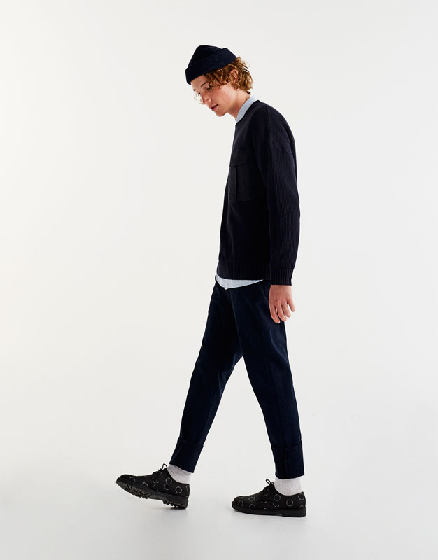 Sweater with contrasting fabric pocket