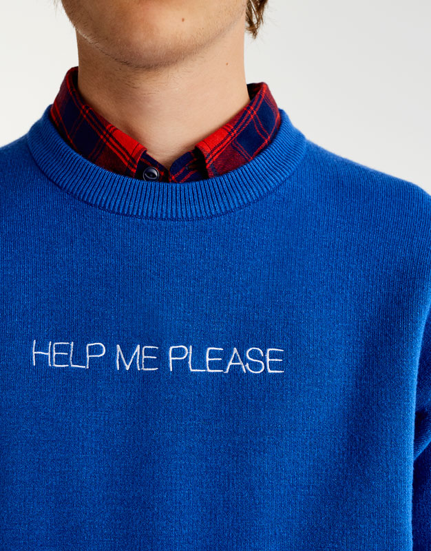'Help me' slogan sweater