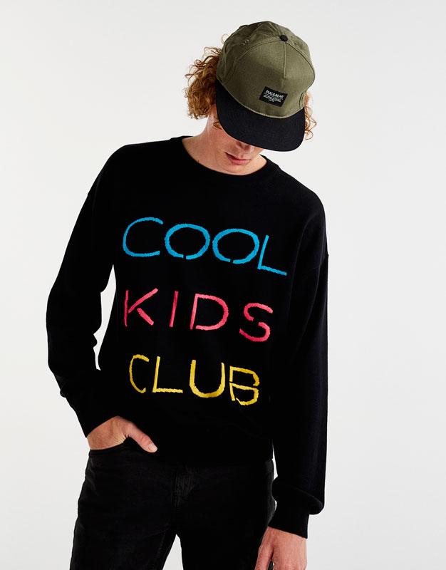 Pullover mit neonfarbenem Schriftzug