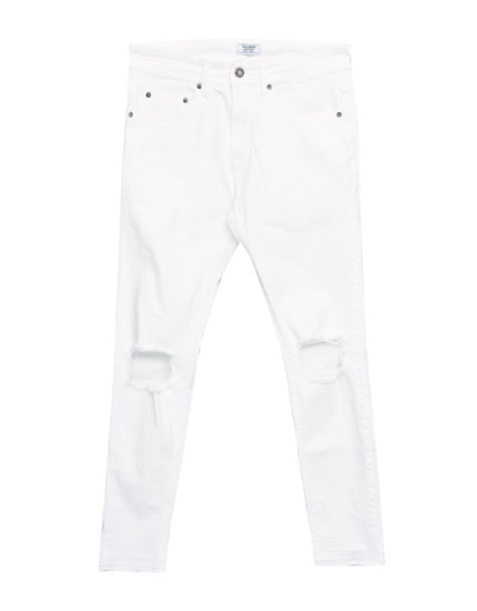 Jeans superskinny fit blanco rotos.