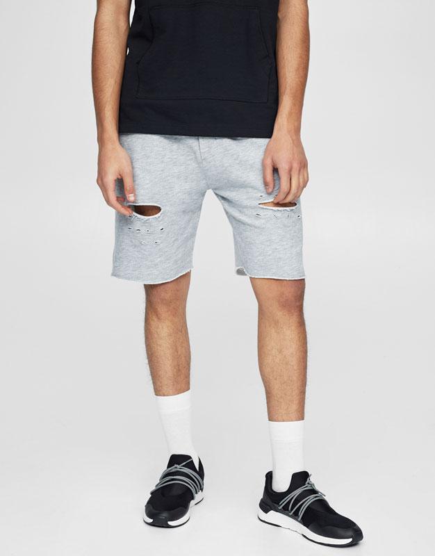Jogging bermuda shorts with rips