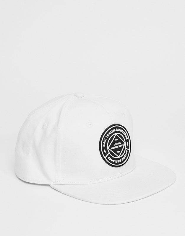 White peaked cap